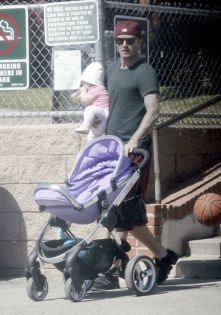 March 08, 2012: MINIMUM USAGE FEE £350 Soccer star David Beckham takes his daughter Harper and son Romeo to the park in Brentwood, California on March 8, 2012. Harper was busy chewing on a bottle of juice while her dada toted her around followed by her brother bouncing a basketball. MINIMUM USAGE FEE £350 Exclusive All Rounder UK Rights Only Pictures by : Flynet © 2012 Tel : +44 20 7510 9535 Email : info@flynetpictures.co.uk